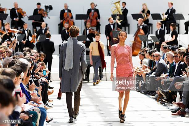 Models walk the runway at the Burberry Prorsum show during The London Collections Men SS16 at Kensington Gardens on June 15 2015 in London England