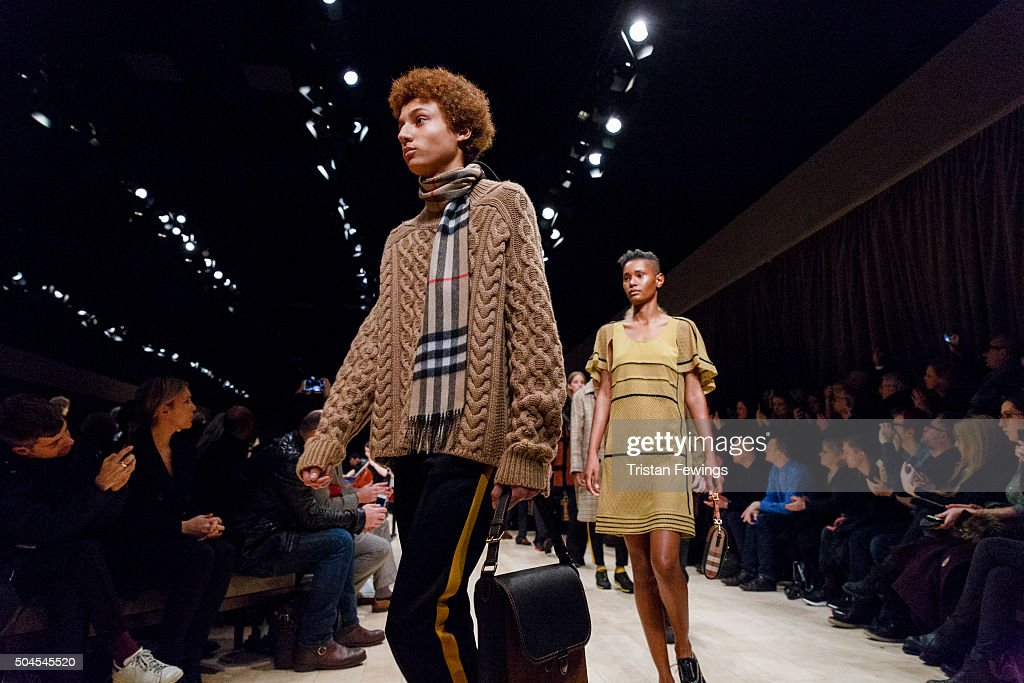 Models walk the runway at the Burberry show during The London Collections Men AW16 at Kensington Gardens on January 11 2016 in London England