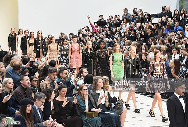 Models walk the runway at the Burberry Womenswear Spring/Summer 2016 show during London Fashion Week at Kensington Gardens on September 21 2015 in...