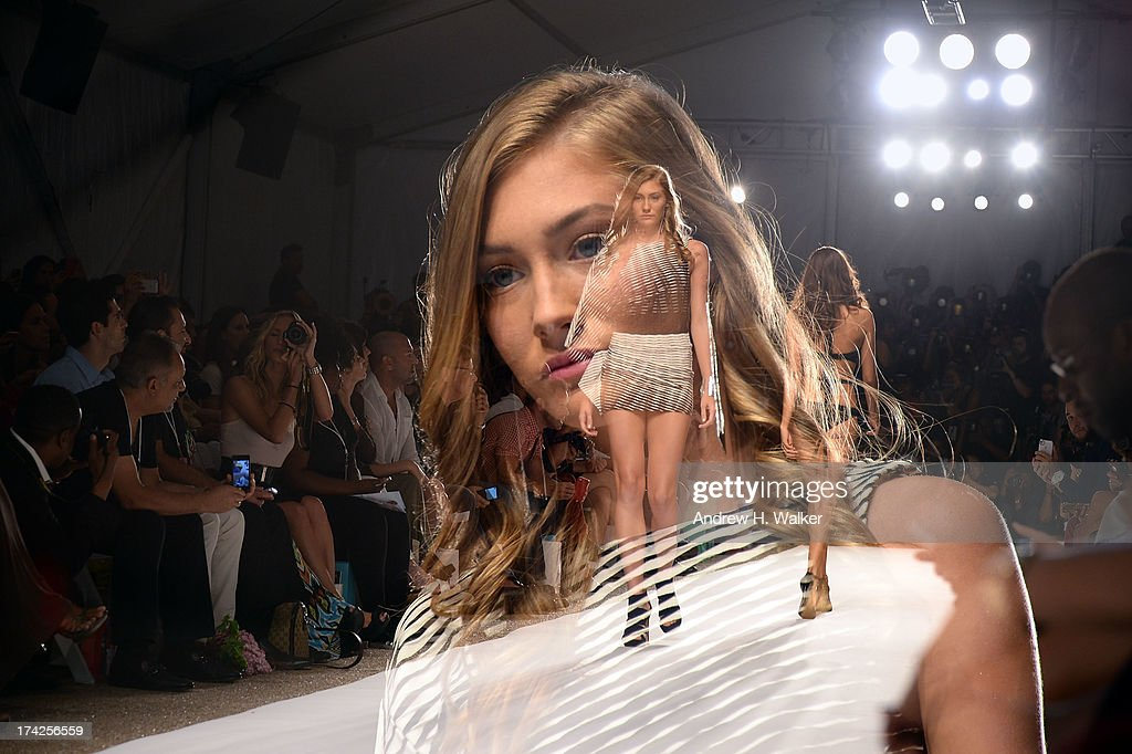 Models walk the runway at the Caitlin Kelly show during Mercedes-Benz Fashion Week Swim 2014 at the Raleigh on July 22, 2013 in Miami Beach, Florida.
