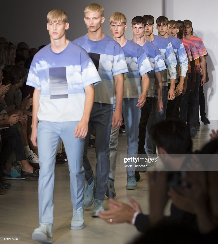 Models walk the runway at the Calvin Klein Spring Summer 2014 fashion show during Milan Menswear Fashion Week on June 23, 2013 in Milan, Italy.