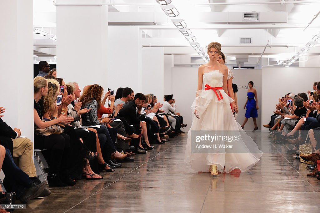 Models walk the runway at the Carmen Marc Valvo Spring 2013 fashion show during Mercedes-Benz Fashion Week at 575 7th Avenue on September 9, 2012 in New York City.