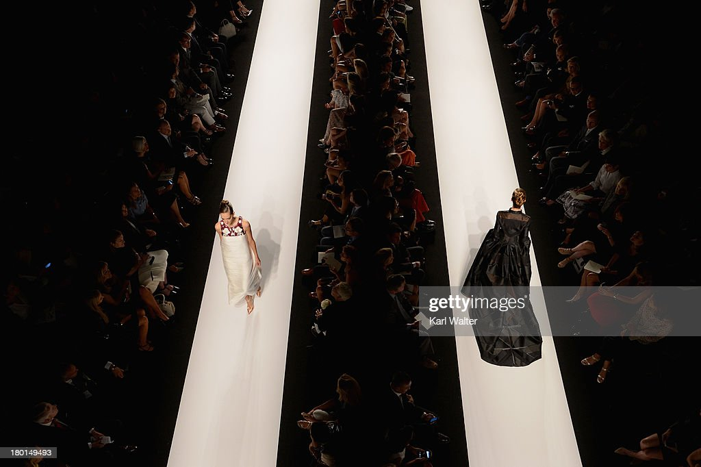 Models walk the runway at the Carolina Herrera fashoin show during Mercedes-Benz Fashion Week Spring 2014 at Lincoln Center for the Performing Arts on September 9, 2013 in New York City.