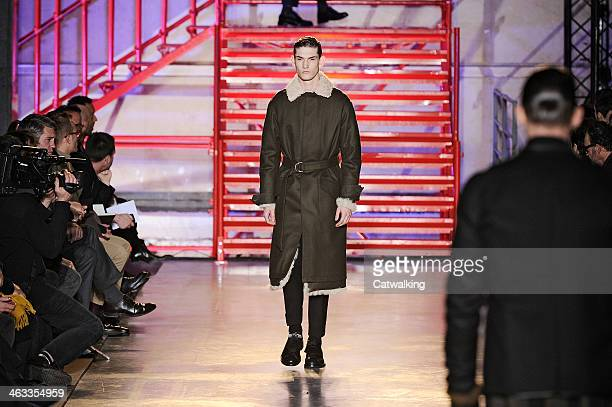 Models walk the runway at the Cerruti Autumn Winter 2014 fashion show during Paris Menswear Fashion Week on January 17 2014 in Paris France