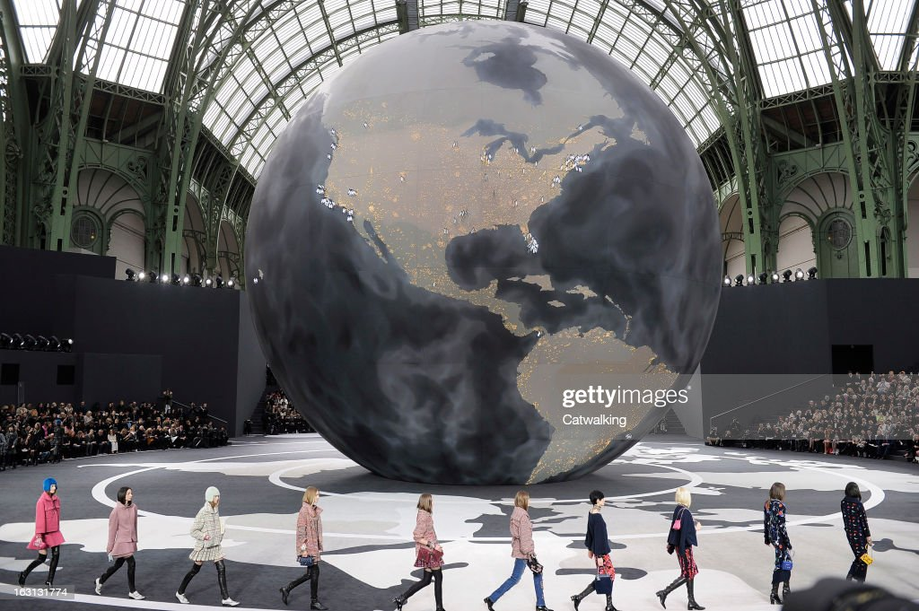 Models walk the runway at the Chanel Autumn Winter 2013 fashion show during Paris Fashion Week on March 5 2013 in Paris France