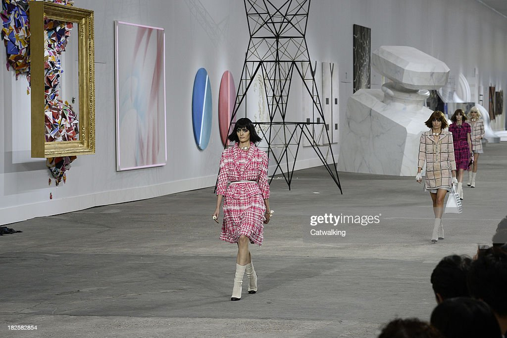 Models walk the runway at the Chanel Spring Summer 2014 fashion show during Paris Fashion Week on October 1, 2013 in Paris, France.