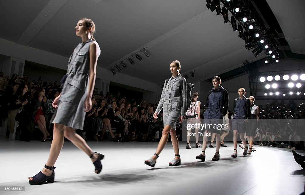 Models walk the runway at the Christopher Raeburn show during London Fashion Week SS14 at BFC Courtyard Showspace on September 13, 2013 in London, England.