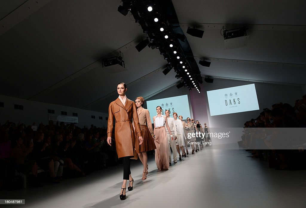 Models walk the runway at the DAKS show during London Fashion Week SS14 at BFC Courtyard Showspace on September 13, 2013 in London, England.