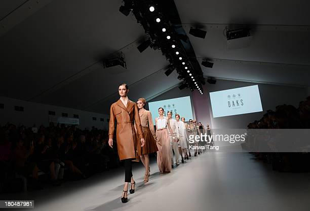Models walk the runway at the DAKS show during London Fashion Week SS14 at BFC Courtyard Showspace on September 13 2013 in London England