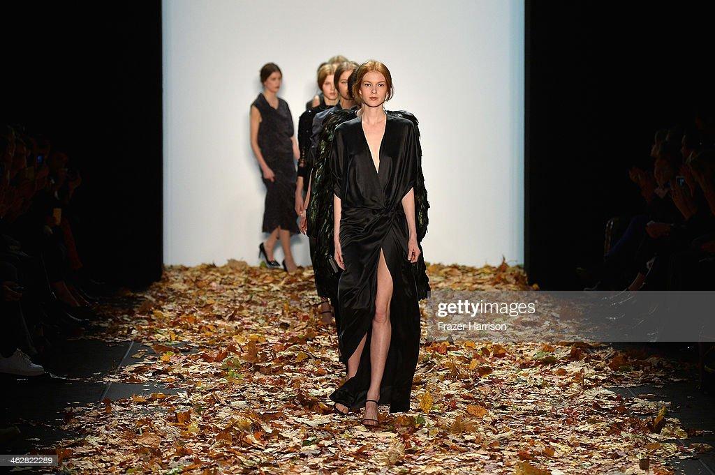 Models walk the runway at the Dawid Tomaszewski show during Mercedes-Benz Fashion Week Autumn/Winter 2014/15 at Brandenburg Gate on January 15, 2014 in Berlin, Germany.