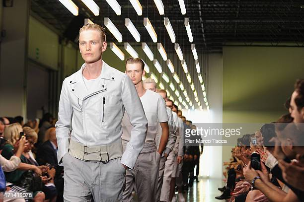 Models walk the runway at the Diesel Black Gold show during Milan Menswear Fashion Week Spring Summer 2014 on June 24 2013 in Milan Italy