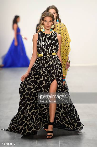 Models walk the runway at the Dimitri show during the MercedesBenz Fashion Week Spring/Summer 2015 at Erika Hess Eisstadion on July 10 2014 in Berlin...