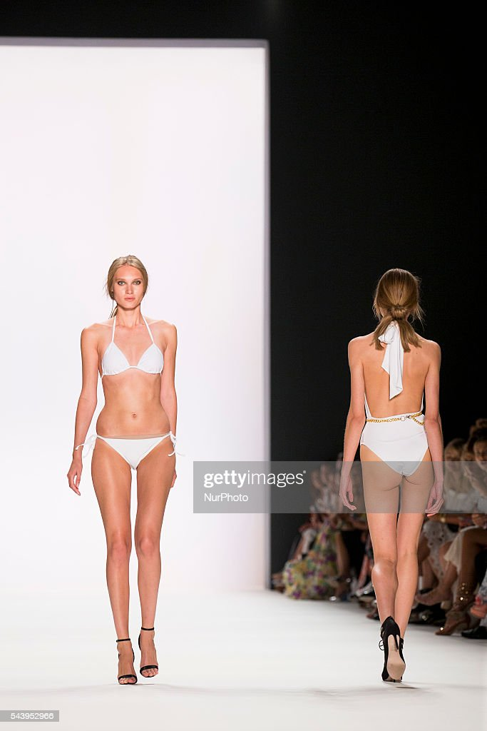 Models walk the runway at the Dimitri show during the Mercedes-Benz Fashion Week Berlin Spring/Summer 2017 at Erika Hess Eisstadion in Berlin, Germany on June 30, 2016.