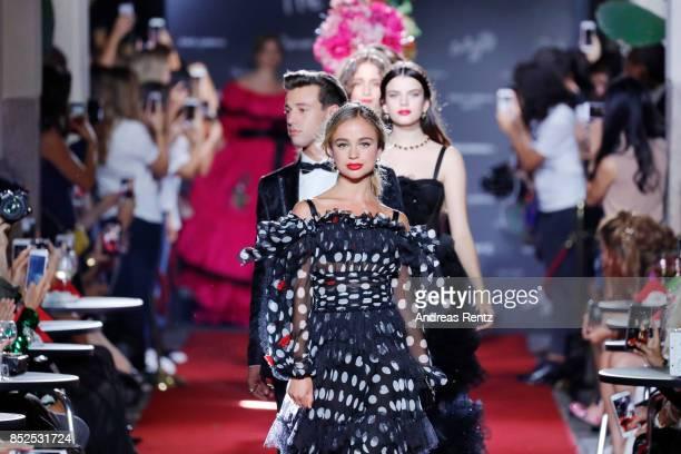 Models walk the runway at the Dolce Gabbana secret show during Milan Fashion Week Spring/Summer 2018 at Bar Martini on September 23 2017 in Milan...