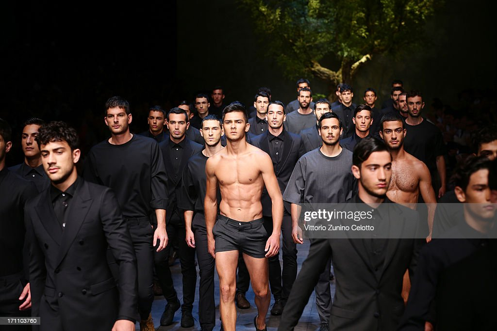 Models walk the runway at the Dolce & Gabbana show during Milan Menswear Fashion Week Spring Summer 2014 on June 22, 2013 in Milan, Italy.