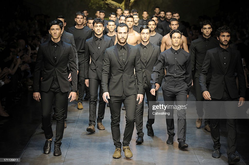Models walk the runway at the Dolce & Gabbana Spring Summer 2014 fashion show during Milan Menswear Fashion Week on June 22, 2013 in Milan, Italy.