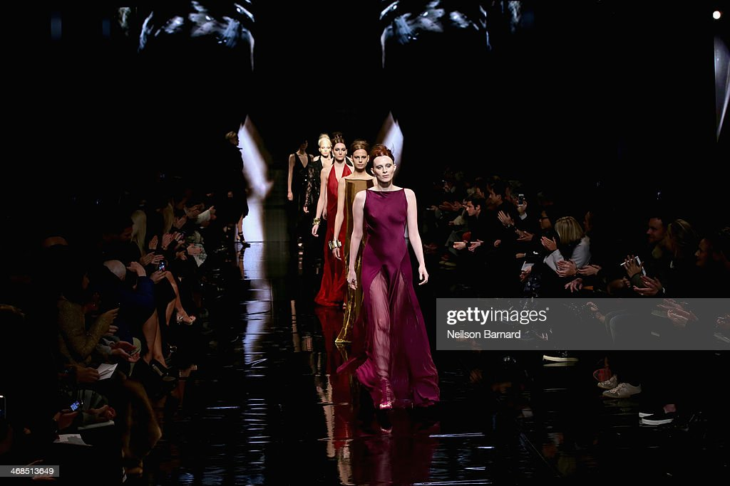 Models walk the runway at the Donna Karan New York 30th Anniversary fashion show during Mercedes-Benz Fashion Week Fall 2014 on February 10, 2014 in New York City.