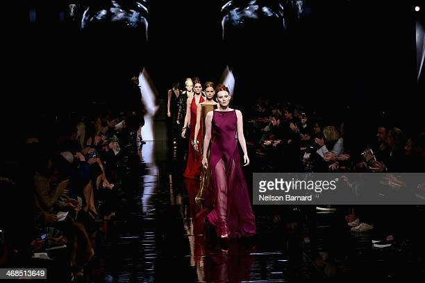 Models walk the runway at the Donna Karan New York 30th Anniversary fashion show during MercedesBenz Fashion Week Fall 2014 on February 10 2014 in...