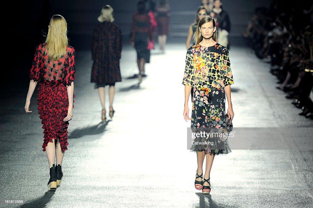 Models walk the runway at the Dries Van Noten Spring Summer 2014 fashion show during Paris Fashion Week on September 25, 2013 in Paris, France.