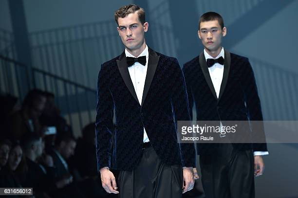 Models walk the runway at the Emporio Armani show during Milan Men's Fashion Week Fall/Winter 2017/18 on January 14 2017 in Milan Italy