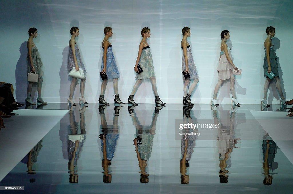 Models walk the runway at the Emporio Armani Spring Summer 2014 fashion show during Milan Fashion Week on September 20, 2013 in Milan, Italy.