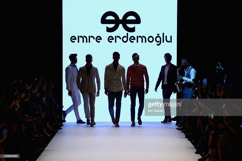 Models walk the runway at the Emre Erdemoglu show during Mercedes-Benz Fashion Week Istanbul s/s 2014 presented by American Express on October 8, 2013 in Istanbul, Turkey.