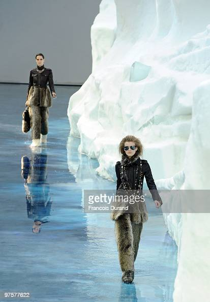 Models walk the runway at the end of the Chanel Ready to Wear show as part of the Paris Womenswear Fashion Week Fall/Winter 2011 at Grand Palais on...