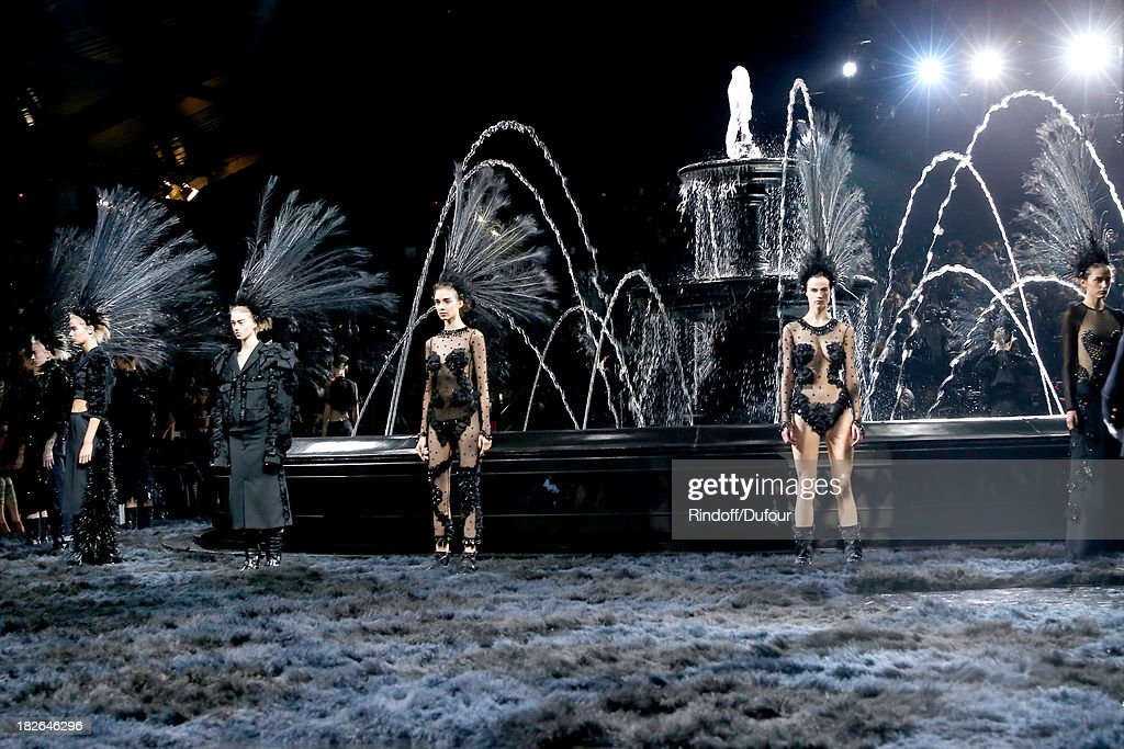 Models walk the runway at the end of the Louis Vuitton show as part of the Paris Fashion Week Womenswear Spring/Summer 2014, held at Le Carre du Louvre on October 2, 2013 in Paris, France.