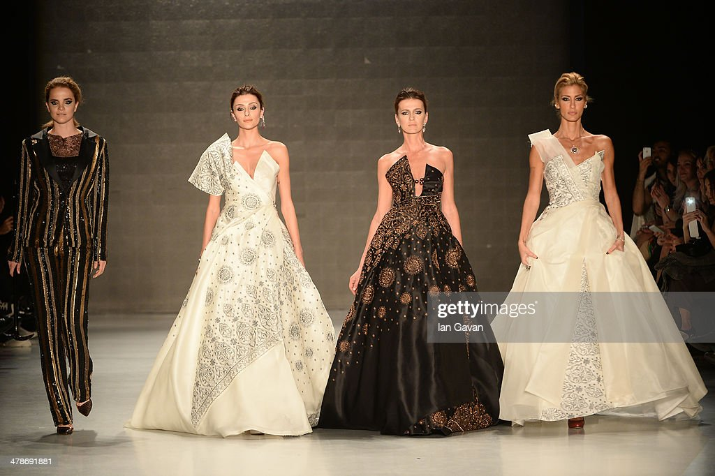 Models walk the runway at the Erol Albayrak show during MBFWI presented by American Express Fall/Winter 2014 on March 14, 2014 in Istanbul, Turkey.