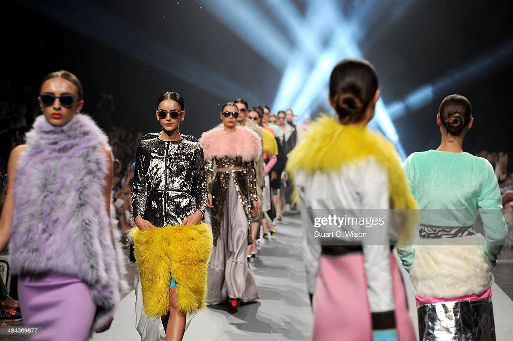 Models walk the runway at the Essa show during Fashion Forward at Madinat Jumeirah on April 12, 2014 in Dubai, United Arab Emirates.