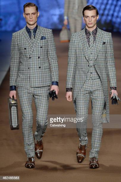 Models walk the runway at the Etro Autumn Winter 2014 fashion show during Milan Menswear Fashion Week on January 13 2014 in Milan Italy