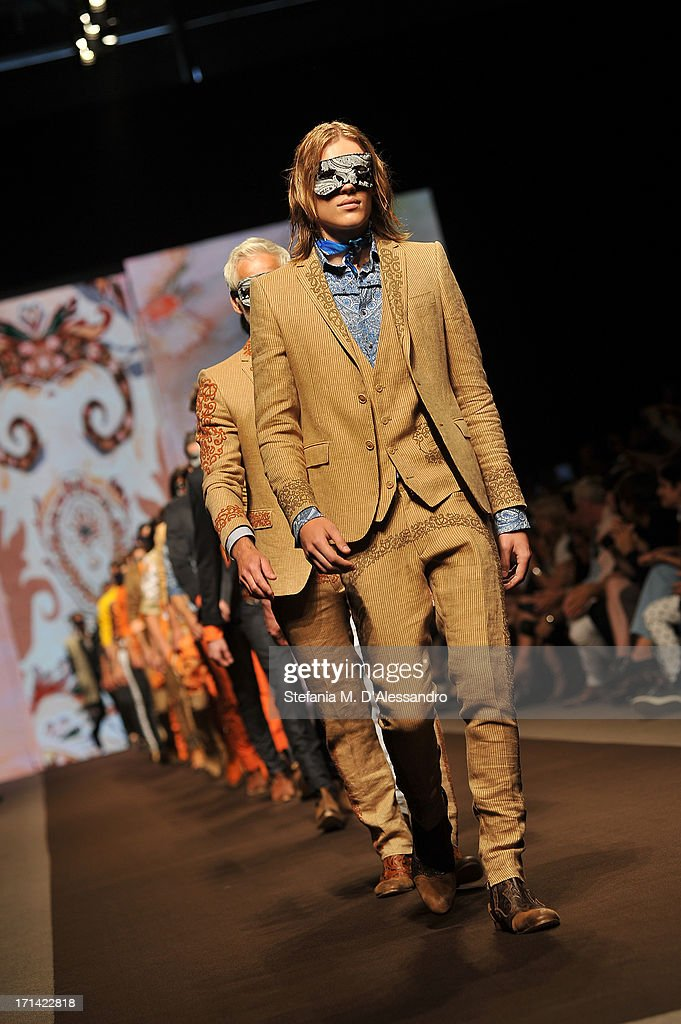 Models walk the runway at the Etro show during Milan Menswear Fashion Week Spring Summer 2014 show on June 24, 2013 in Milan, Italy.
