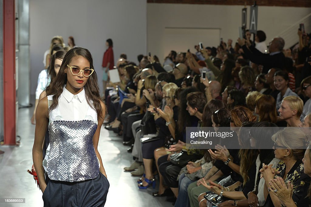 Models walk the runway at the Frankie Morello Spring Summer 2014 fashion show during Milan Fashion Week on September 23, 2013 in Milan, Italy.