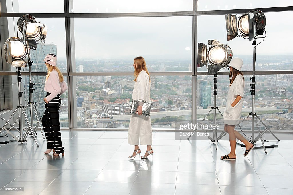 Models walk the runway at the front row at the Whistles show during London Fashion Week SS14 at Heron Tower on September 14 2013 in London England