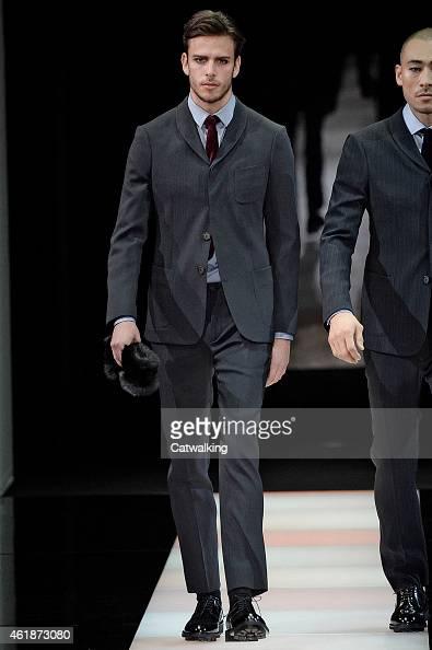 Models walk the runway at the Giorgio Armani Autumn Winter 2015 fashion show during Milan Menswear Fashion Week on January 20 2015 in Milan Italy