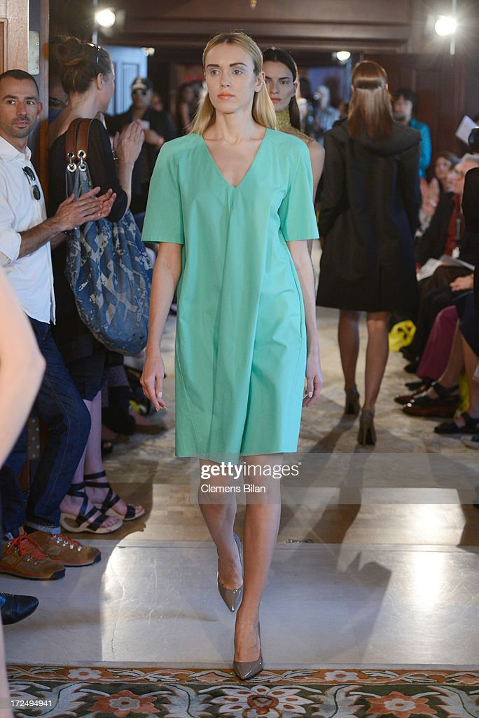 Models walk the runway at the Green Showroom during Mercedes-Benz Fashion Week Spring/Summer 2014 at Brandenburg Gate on July 2, 2013 in Berlin, Germany.