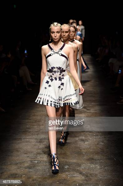 Models walk the runway at the Gulcin Cengel show during Mercedes Benz Fashion Week Istanbul SS15 at Antrepo 3 on October 17 2014 in Istanbul Turkey