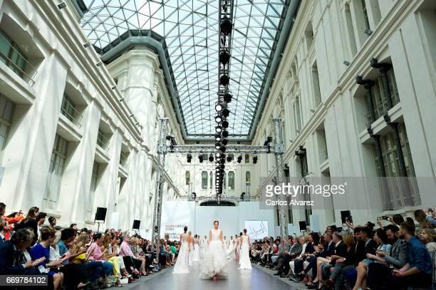 Models walk the runway at the Hannibal Laguna show during the Madrid Bridal Week 2017 at Palacio de Cibeles on April 18 2017 in Madrid Spain