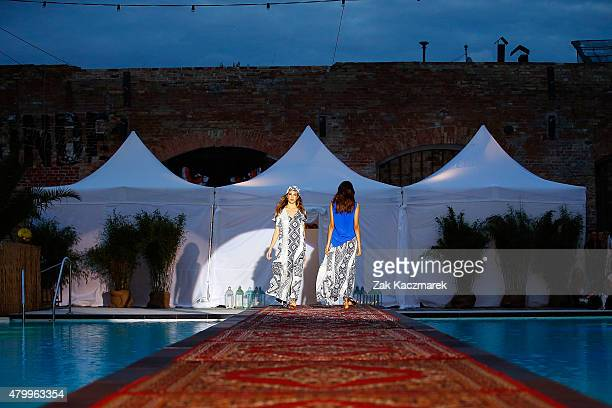 Models walk the runway at the Holy Ghost show during the MercedesBenz Fashion Week Berlin Spring/Summer 2016 at on July 8 2015 in Berlin Germany