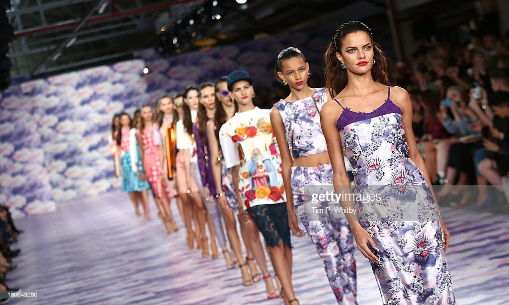 Models walk the runway at the House Of Holland show at Brewer Street Car Park during London Fashion Week SS14 on September 14, 2013 in London, England.