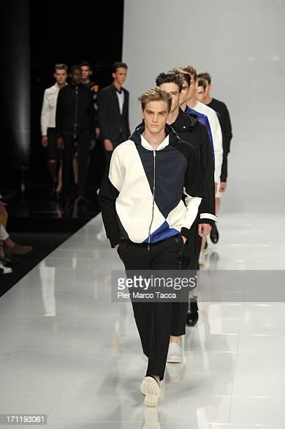 Models walk the runway at the Iceberg show during Milan Menswear Fashion Week Spring Summer 2014 on June 23 2013 in Milan Italy