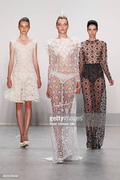 Models walk the runway at the Irene Luft show during the MercedesBenz Fashion Week Spring/Summer 2015 at Erika Hess Eisstadion on July 11 2014 in...