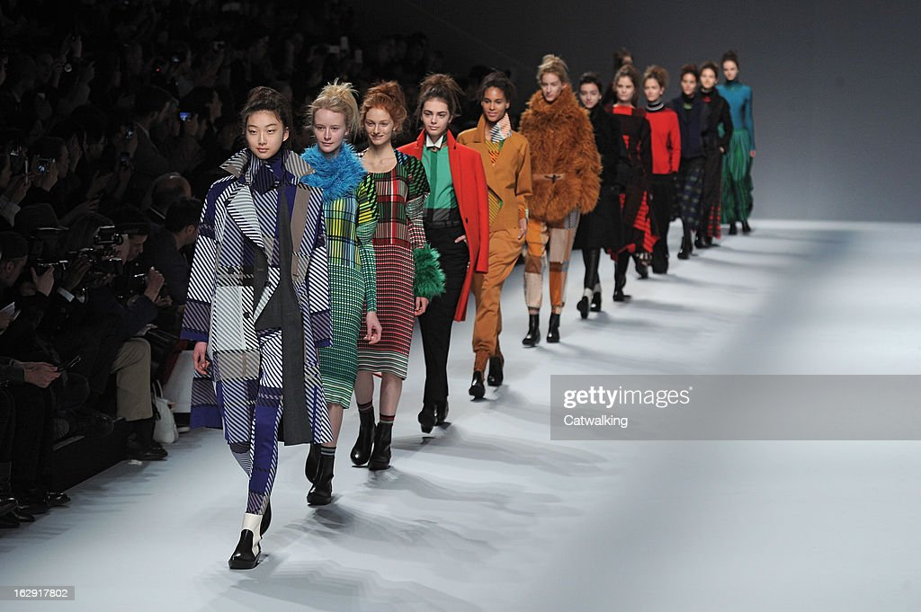 Models walk the runway at the Issey Miyake Autumn Winter 2013 fashion show during Paris Fashion Week on March 1, 2013 in Paris, France.