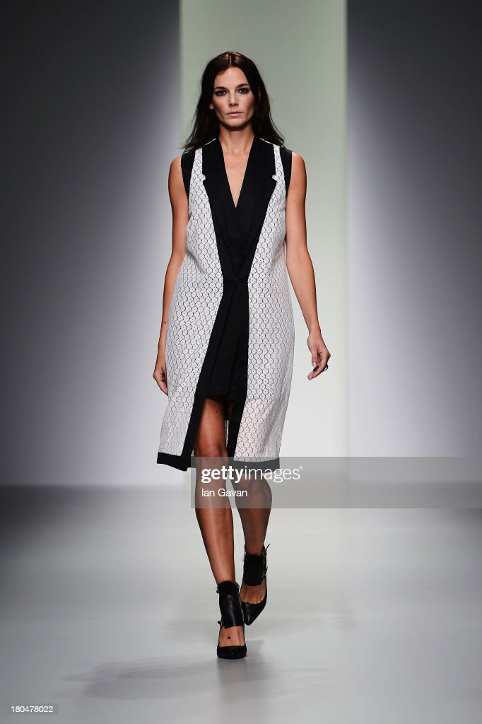 Models walk the runway at the Jean-Pierre Braganza show during London Fashion Week SS14 at BFC Courtyard Showspace on September 13, 2013 in London, England.