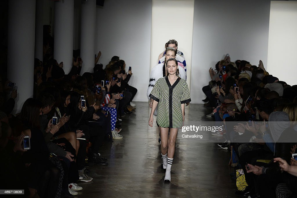 Models walk the runway at the Jeremy Scott Autumn Winter 2014 fashion show during New York Fashion Week on February 12, 2014 in New York, United States.