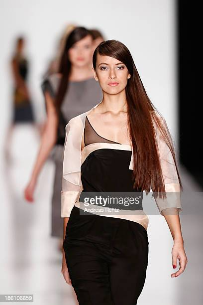Models walk the runway at the Julia Dalakian show during MercedesBenz Fashion Week Russia S/S 2014 on October 28 2013 in Moscow Russia