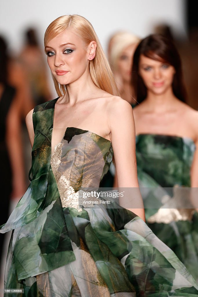 Models walk the runway at the Julia Dalakian show during Mercedes-Benz Fashion Week Russia S/S 2014 on October 28, 2013 in Moscow, Russia.