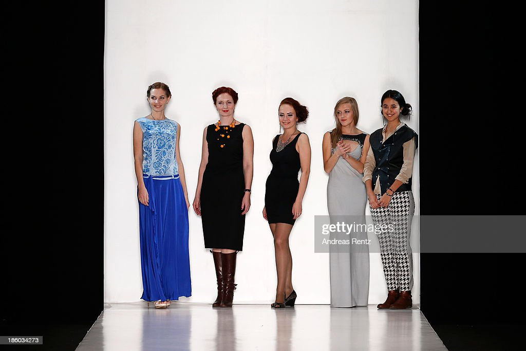 Models walk the runway at the Julia Nikolaeva show during Mercedes-Benz Fashion Week Russia S/S 2014 on October 27, 2013 in Moscow, Russia.