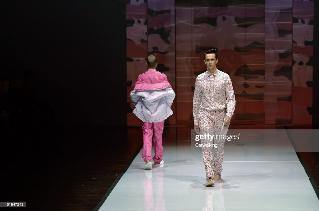 Models walk the runway at the Julian Zigerli Autumn Winter 2014 fashion show during Milan Menswear Fashion Week on January 11, 2014 in Milan, Italy.
