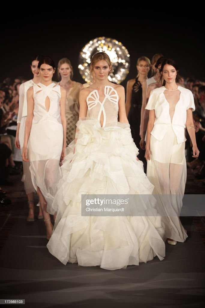 Models walk the runway at the Kaviar Gauche Show during Mercedes-Benz Fashion Week Spring/Summer 2014 at St. Agnes Church on July 3, 2013 in Berlin, Germany.